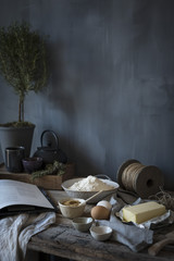 Butter, brown sugar and flour ingredients on a rustic table