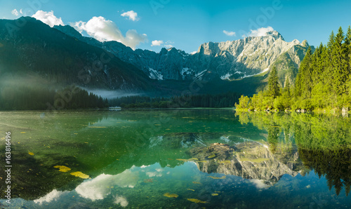 Wall mural High resolution panorama of the Laghi di Fusine alpine lake in the Julian Alps in Italy