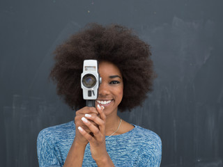 african american woman using a retro video camera