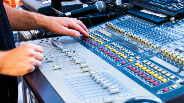 Close view of man using mixing console