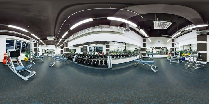 Big modern fitness gym with dumbbells weights and other sport equipment full 360 degree panorama in equirectangular spherical projection