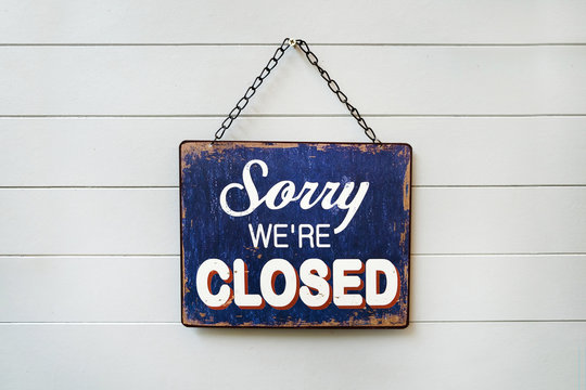 Sorry We're Closed Sign hanging on the wall