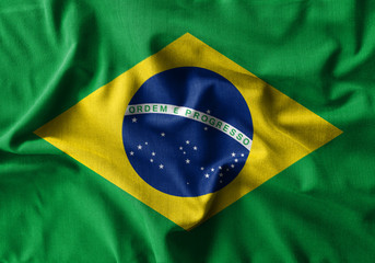 Photo sur Aluminium Brésil Brazil flag painting on high detail of wave cotton fabrics .