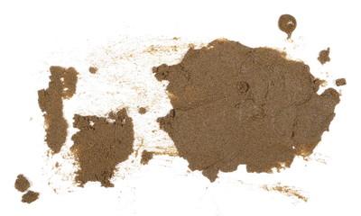 Scattered wet desert sand isolated on white backgrounds