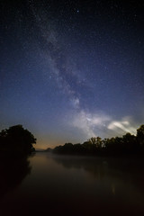 Starry night sky with the Milky Way over the river.