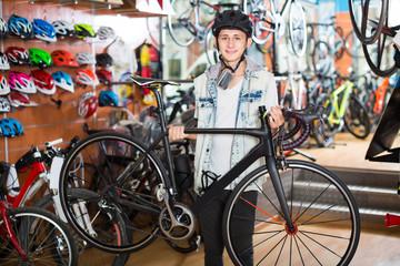 Teenage boy looking for new sport bike