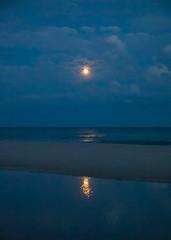 Moonrise over the Sea with Reflection and Sandbar