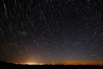 Night sky with bright stars trails. Astrophotography of outer space.