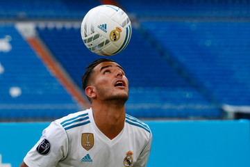 Real Madrid's new player Theo Hernandez heads the ball during his presentation at the Santiago Bernabeu Stadium in Madrid