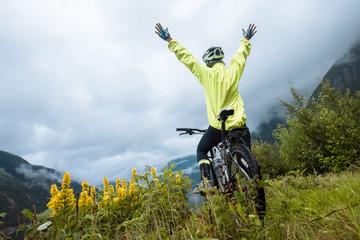 Mountain bike cyclist near fjord, Norway