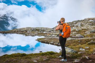 Nature photographer tourist near Norway lake