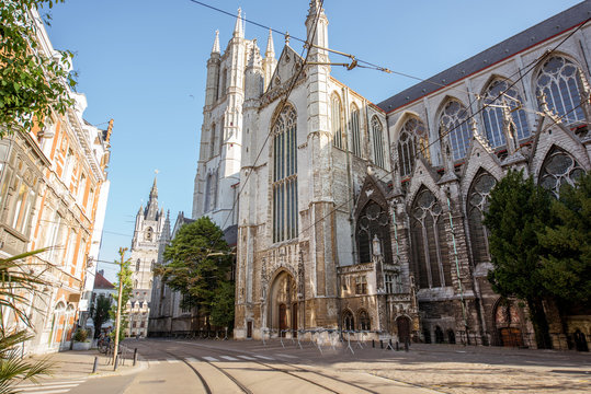 Street view with saint Bavo cathedral during the morning light in Gent city, Belgium