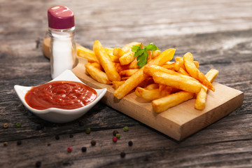 French fries on chopping board