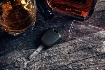 Car keys on the table with empty glass