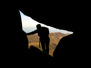 Young girl enjoying view from mountain summit