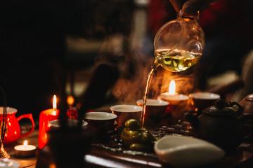 Tea ceremony. Hot chinese tea with tea desk