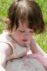 Portrait of a cute little girl smiling outside