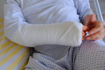 Broken arm wrapped with plaster