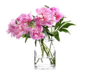 Glass vase with beautiful peonies on white background