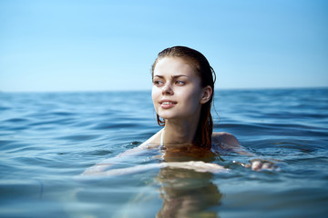 Beautiful young woman resting on the sea, ocean, beach, summer, sun