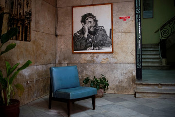 A picture of  late Cuban President Fidel Castro hangs on the wall of a Cuban Communist Party Committee in downtown Havana