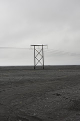Telephone line in the middle of a volcanic rock field
