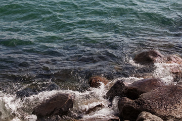 lakeshore tide among the rocks