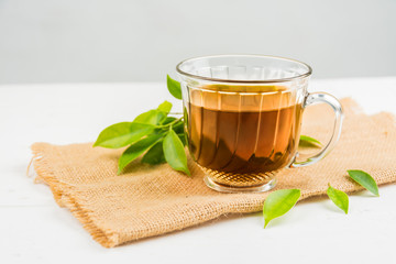 tea with  Tea glass on white wood