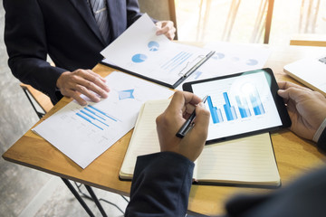 business man financial inspector and secretary making report, calculating or checking balance. Internal Revenue Service inspector checking document.
