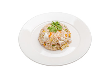 Tasty Thai cuisine, crab meat fried rice beautiful serving in white plate isolated on white background.
