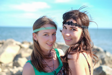 Portrait of two beautiful young hippy women on the beach