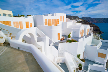 Oia town on Santorini island, Greece. Traditional and famous white and rose  houses at sunny day