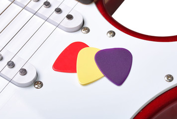 Colored picks on a guitar