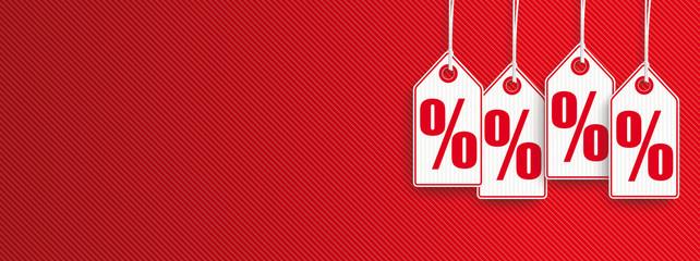 Roter Headliner mit 4 Preisschildern mit Prozentzeichen