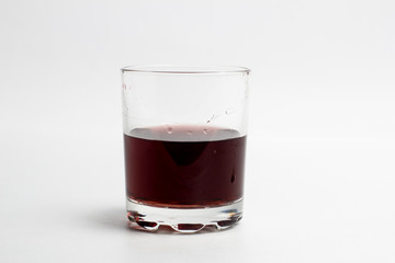 Dark red cocktail in a glass