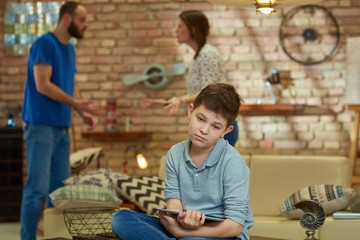 Sad boy arguing parents