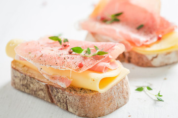 Sandwich with ham and cheese for breakfast on white table