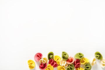 Multicolored Italian pasta. Delicious dinner for children. Pasta the boat. White background.