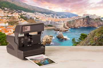 retro instant photo camera with photo of Dubrovnik, Croatia.