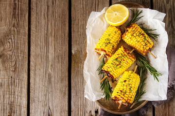 Corn grilled with salt and spices. Dark background. Fast food in the summer.