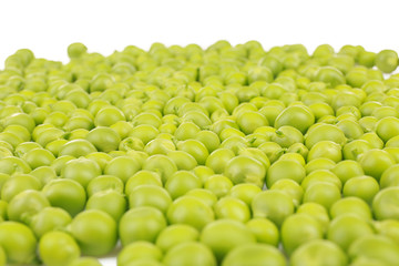 Pile of fresh green peas on white background, closeup