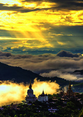 This temple Pha Son Kaew is public In Phetchabun,Thailand. This was taken at a scenic sunrise.The temple on the hilltop.The morning mist is beautiful just with tourists.
