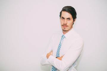 Serious Middle-aged Business Man with Arms Crossed