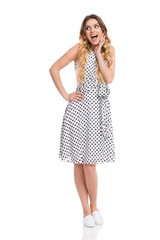 Excited Woman In White Dotted Dress Is Shouting And Looking Away