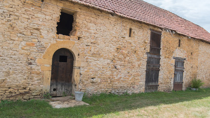 Barn in ruin with former wooden door, in Burgundy, France