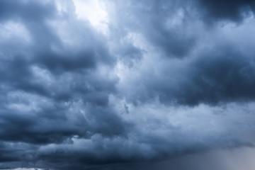 storm cloud background during raining. Dark Clouds. Huge black clouds on dark sky.