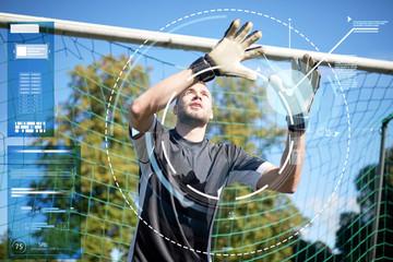 goalkeeper or soccer player at football goal