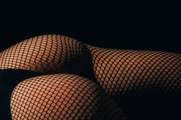 Fishnet pantyhose tights and black panties on female butt