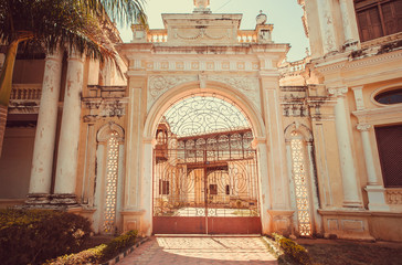 Gates with arch of colonial stule building in Mysore of Karnataka, India.