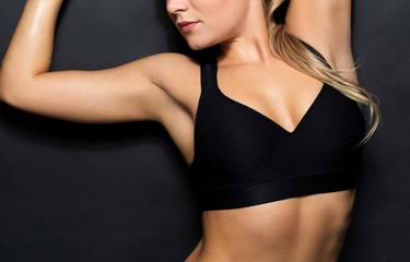 close up of woman in black sportswear posing